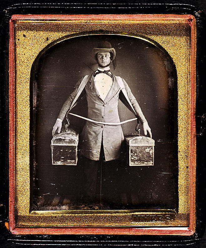 [Occupational portrait of a peddler, full-length, standing, facing front, with two bags held at his sides by a harness, neck brace visible between legs] Daguerreotype by Myers, between 1840 and 1860. //hdl.loc.gov/loc.pnp/cph.3g04161