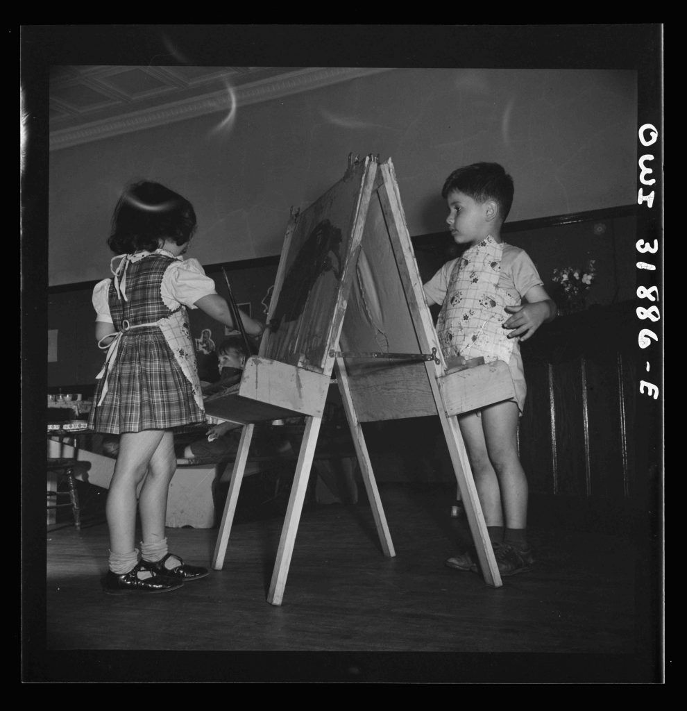 New Britain, Connecticut. A child care center, opened September 15, 1942, for thirty children, age two to five, of mothers engaged in war industry. The hours are 6:30 a.m. to 6 p.m. six days per week. Children painting and coloring. Photo by Gordon Parks, June 1943. //hdl.loc.gov/loc.pnp/fsa.8d30782