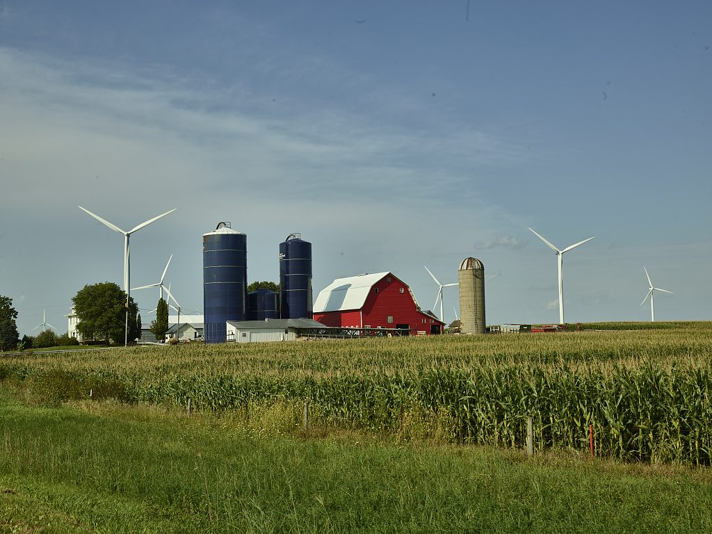 Farm scene including a bright-red barn, three silos (one vintage, two modern), and quite modern wind turbines in Hardin County, Iowa. Photograph by Carol Highsmith, 2016-08-17. //hdl.loc.gov/loc.pnp/highsm.39861