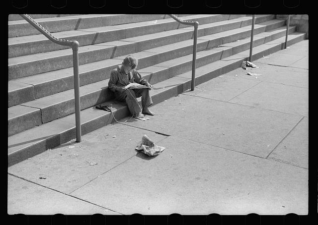Boy reading funny paper on steps of public library, Milwaukee, Wisconsin. Photo by John Vachon, 1940 July. //hdl.loc.gov/loc.pnp/fsa.8a06492