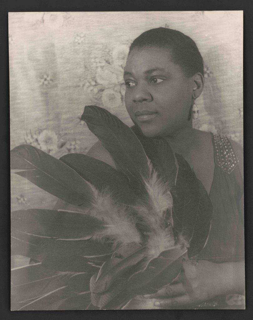 Portrait of Bessie Smith holding feathers. Photograph by Carl Van Vechten, 1936 Feb 3. //hdl.loc.gov/loc.pnp/ppmsca.09571