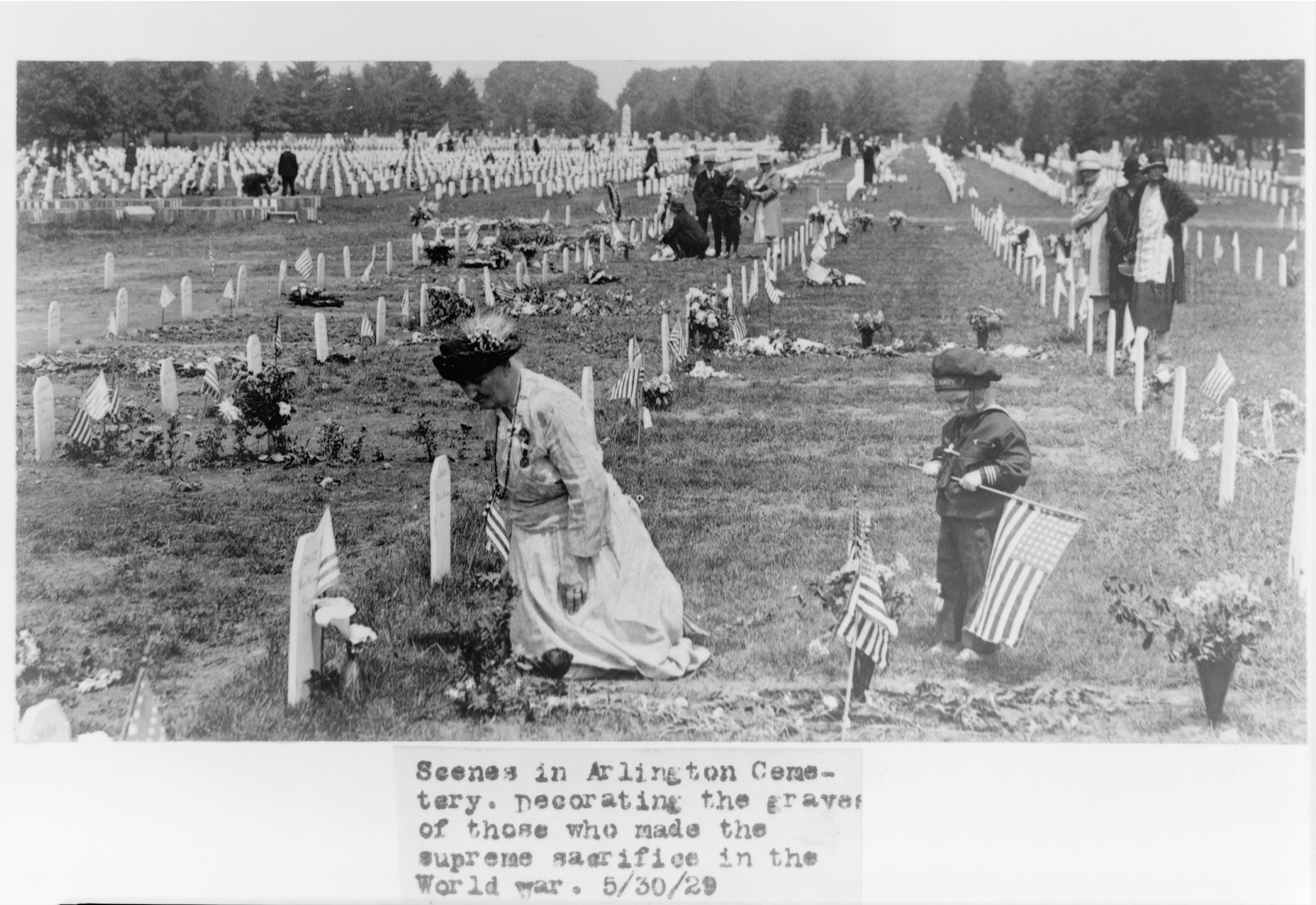Scenes in Arlington Cemetery. Decorating the graves of those who made the supreme sacrifice in the World War. Photo by National Photo Company, 1929 May 30. //hdl.loc.gov/loc.pnp/cph.3c00028