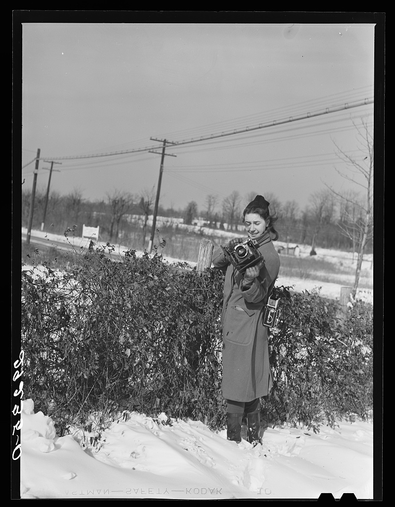 [Untitled negative showing Marion Post Wolcott standing in snow with cameras] Photo by Arthur, Rothstein, 1940 Jan. //hdl.loc.gov/loc.pnp/fsa.8b19315