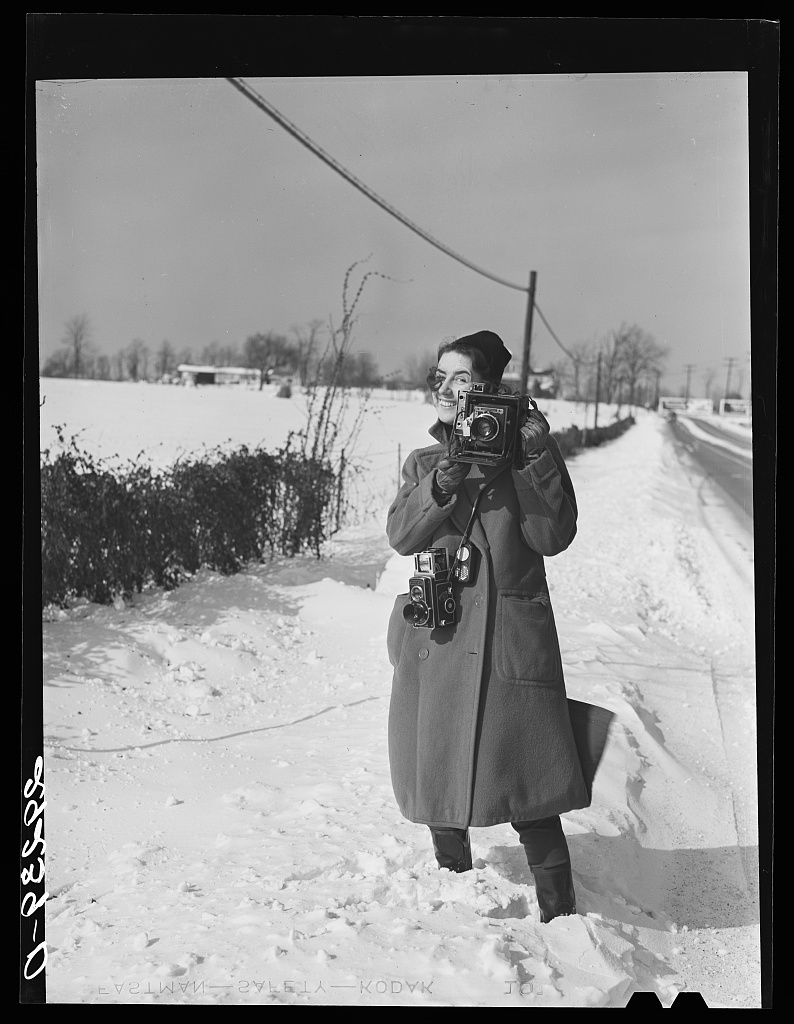 [Untitled negative showing Marion Post Wolcott standing in snow with cameras] Photo by Arthur, Rothstein, 1940 Jan. //hdl.loc.gov/loc.pnp/fsa.8b19319