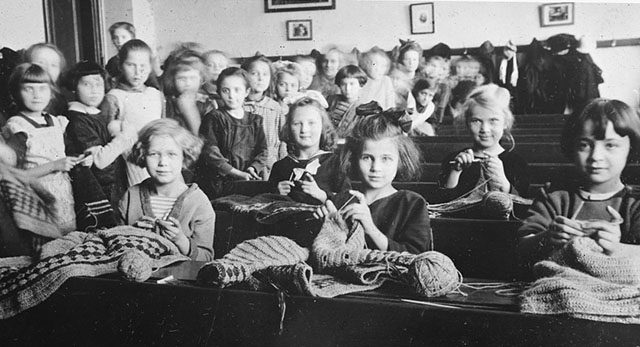 Vinohrady (Prague) primary school knitting and crocheting for Russian aid, Prague Czecho-Slovak Junior Red Cross. Photo, American National Red Cross Collection, 1922. //hdl.loc.gov/loc.pnp/anrc.14803