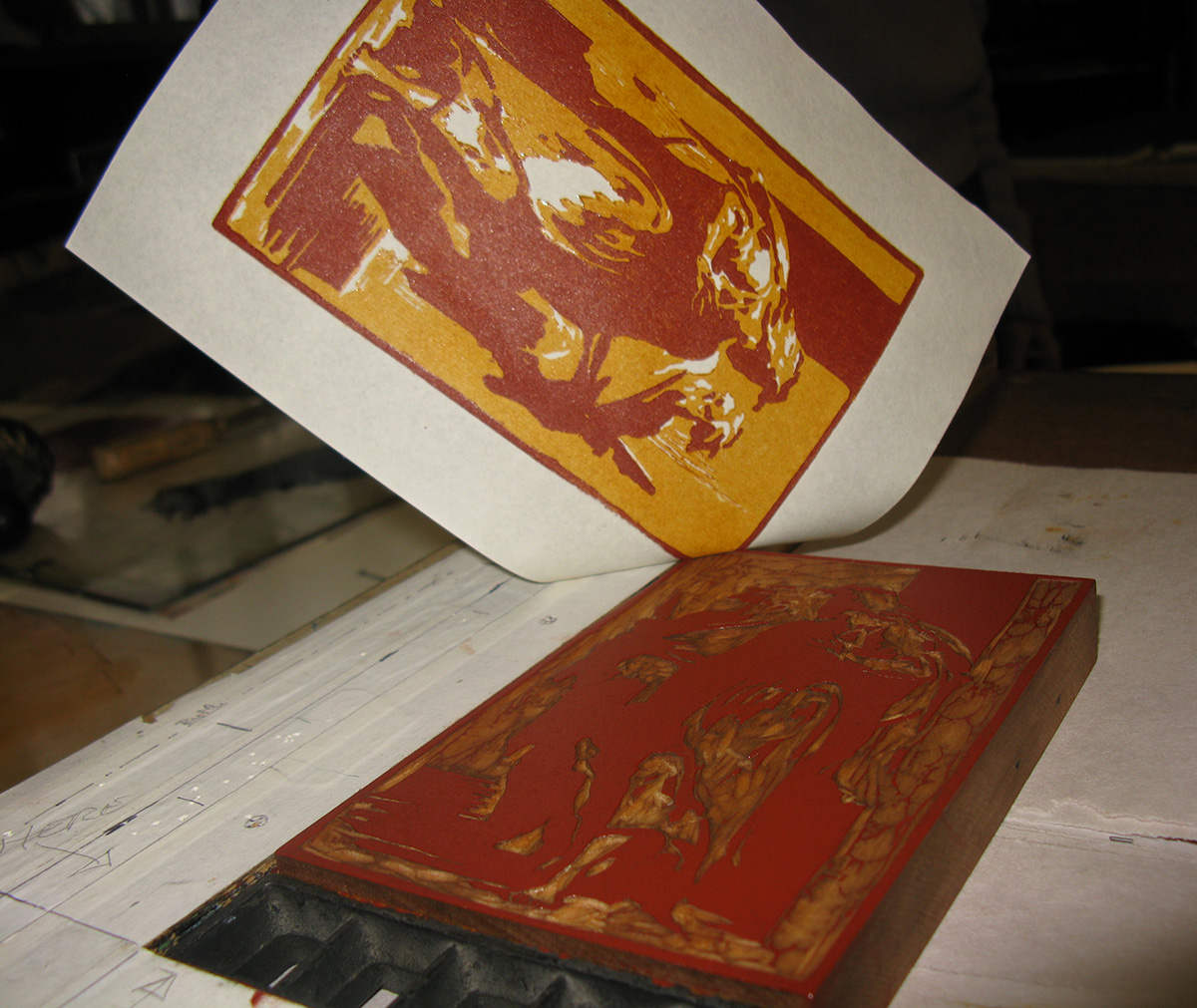 Pulling an impression from the red-ochre mid-tone block, which was printed over the yellow-ochre ink from the light-tone block. The final, key block has yet to be printed in lamp black to provide the linear outlines of the composition. Photo by Katherine Blood, 2018.
