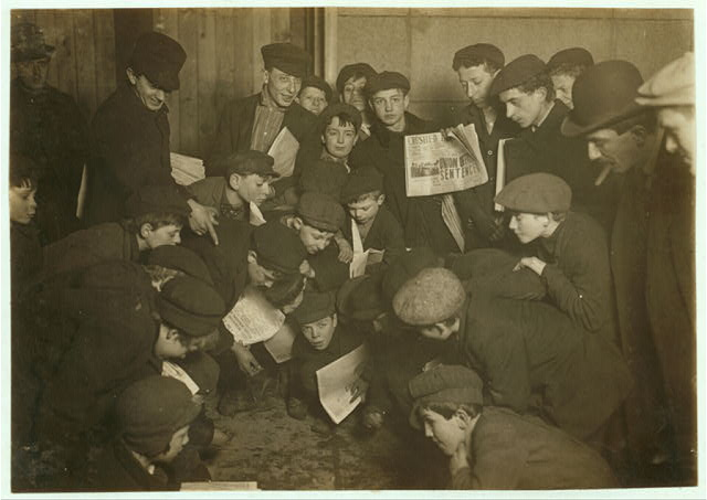 Amusing themselves while waiting for morning papers...New York, NY. Photo by Lewis Hine, 1908 February. National Child Labor Committee Collection. //hdl.loc.gov/loc.pnp/nclc.03181