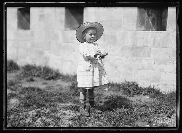 "Renee Grouyer, ""the adopted daughter"" of the Intelligence Section of the Army Field Clerks, 2nd Section, GHQ, cant's play ball very well... Photo by Lewis Hine, 1918 August. American National Red Cross Collection. //hdl.loc.gov/loc.pnp/anrc.17112"