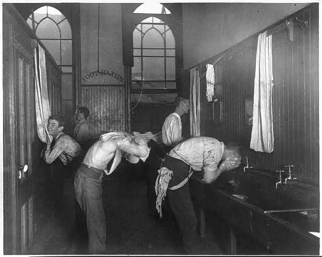 """Washing up"" in the newsboys' lodging house. Photo by Jacob Riis, ca. 1890. //hdl.loc.gov/loc.pnp/cph.3a18571"
