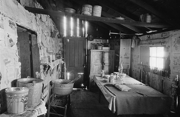Kitchen and washroom of two room mountain shack, Route U.S. 11, a few miles east of Marshall, North Carolina. Photo by Carl Mydans, 1936 March. //hdl.loc.gov/loc.pnp/fsa.8a01320