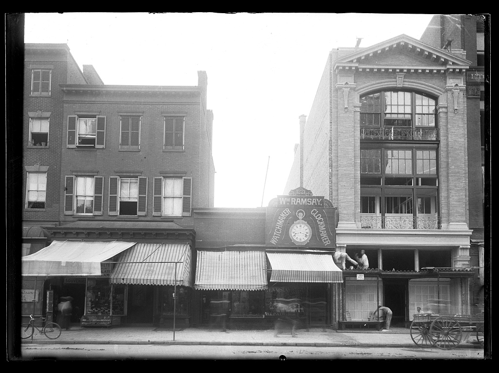 [View of F Street, N.W., North side, between 12th & 13th Streets showing various businesses fronts along the block; workers repairing building] Photo, 1901. //hdl.loc.gov/loc.pnp/ppmsca.40281