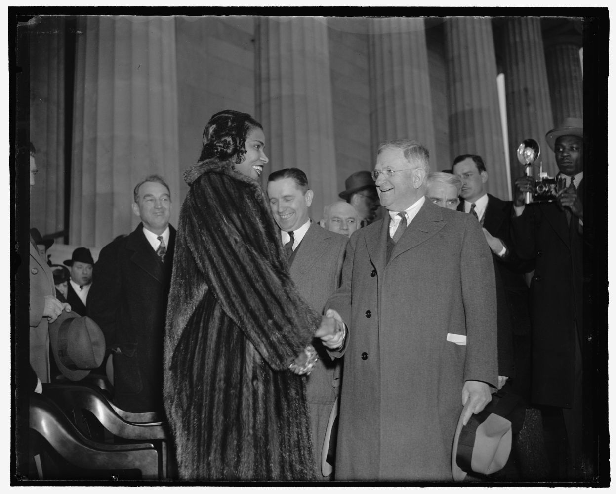 <em>Interior Secretary Ickes congratulates Marian Anderson at concert. Washington, D.C., April 9. Secretary of the Interior Harold Ickes, who introduced Marian Anderson at her open-air concert at the shrine of the president who freed her race from slavery, congratulating her after the concert to which an estimated 75,000 listened. </em>Photo by Harris & Ewing, 1939 April 9. //hdl.loc.gov/loc.pnp/hec.26451