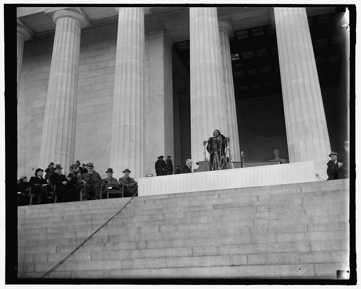 <em>Washington's prominent figures listen to Marian Anderson's singing. Washington, D.C., April 9. Behind Marian Anderson, the heroic statue of Lincoln; beside her, Cabinet members and Senators; before her a crowd of 75,000 black and white listeners. Left to right - Secretary of the Treasury Henry Morganthau, Mrs. Morganthau, Secretary of the Interior Harold Ickes, [...] at the piano, Marian Anderson. </em>4-9-39. Photo by Harris & Ewing, 1939 April 9. //hdl.loc.gov/loc.pnp/hec.26452