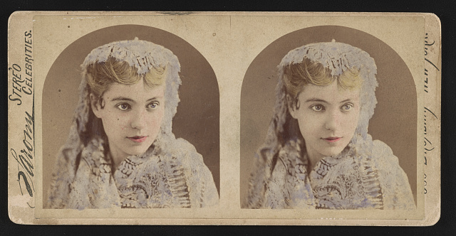 Head-and-shoulders portrait of a young woman wearing lace scarf