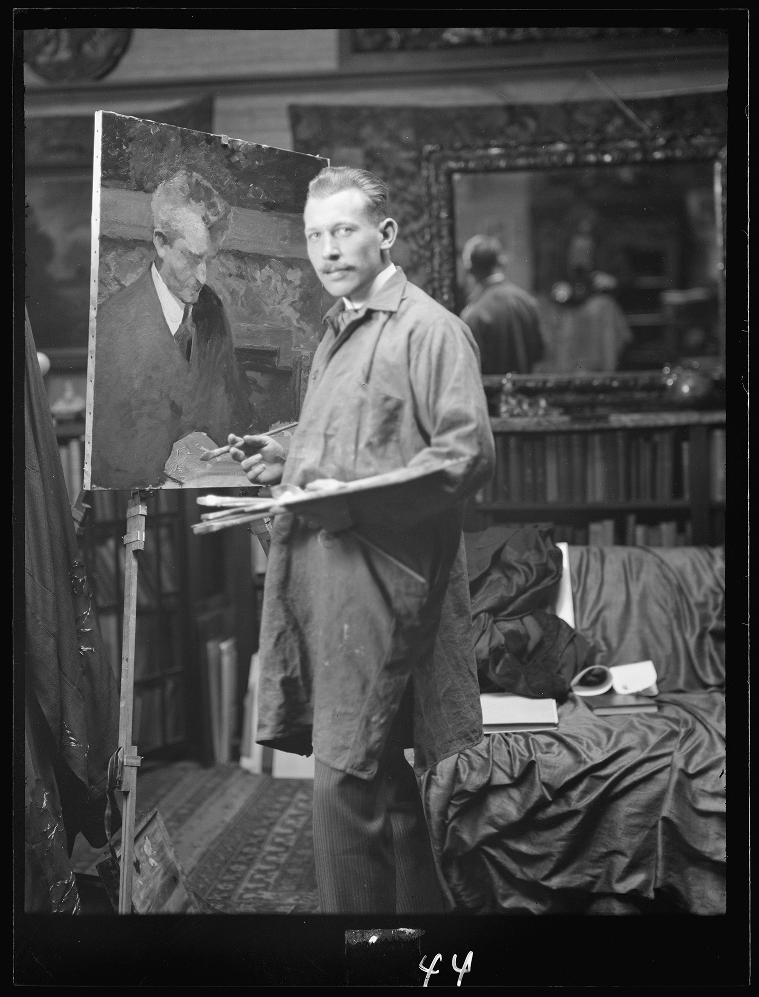 J.M. Williamson painting a portrait of Arnold Genthe. Photo by Arnold Genthe
