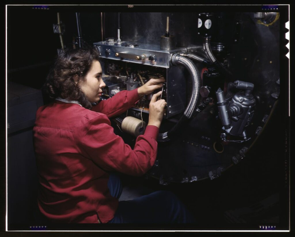 Switch boxes on the firewalls of B-25 bombers are assembled by women workers at North American [Aviation, Inc.]'s Inglewood, Calif., plant. Photo by Alfred T. Palmer, 1942. //hdl.loc.gov/loc.pnp/fsac.1a35311