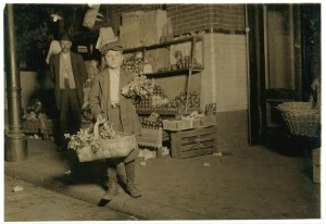 11-year-old celery vendor Gus Strateges, photographed by Lewis Wickes Hine