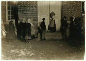National Child Labor Committee. No. 435. Flashlight photo of children on night shift going to work at 6 P.M. on a cold, dark December night.