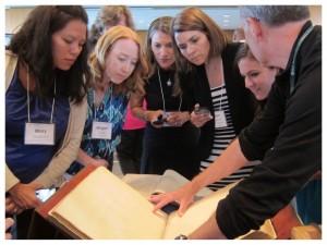 Teachers study historic maps in a Library of Congress Summer Teacher Institute