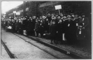 Strike in Lawrence, Massachusetts, with many children posed on sidewalk. 1912