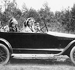 Coeur D'Alene man, Phillip Wildshoe and family, in his Chalmers automobile