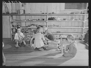 Agricultural and packing house workers' children playing in the twenty-four hour a day nursery at Osceola migratory labor camp. Belle Glade, Florida. Marion Post Wolcott, February 1941.