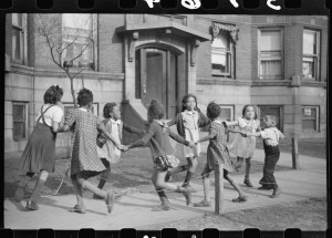 "Children playing ""ring around a rosie"" in one of the better neighborhoods of the Black Belt, Chicago, Illinois. Edwin Rosskam, August 1941."