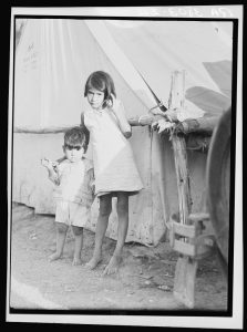 Migrant Mexican children in contractor's camp at time of early pea harvest. Nipomo, California. Dorothea Lange, 1935