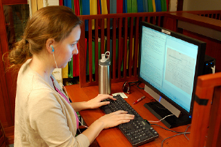 Student worker transcribes Freedom Suits, by WashULibraries, on Flickr