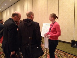 Courtney Egan presenting the reformatted video matrix at the AMIA Poster Session.  Photo by Kate Murray