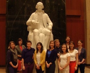 Residents pose with the James Madison statue at the Library of Congress. Photo credit: Ali Fazal