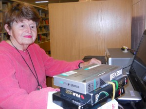 Marlene DeBoer digitizing VHS tapes of her grandchildren. Photo by Campbell County Public Library.
