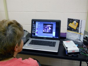 Marlene DeBoer digitizing VHS tapes of her grandchildren who are now in their mid-twenties. Photo by Campell County Public Library.