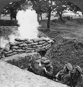 "Three British soldiers in trench under fire during World War I. <a href=""//www.loc.gov/item/96505409/"" target=""_blank"">The Library of Congress.</a>"