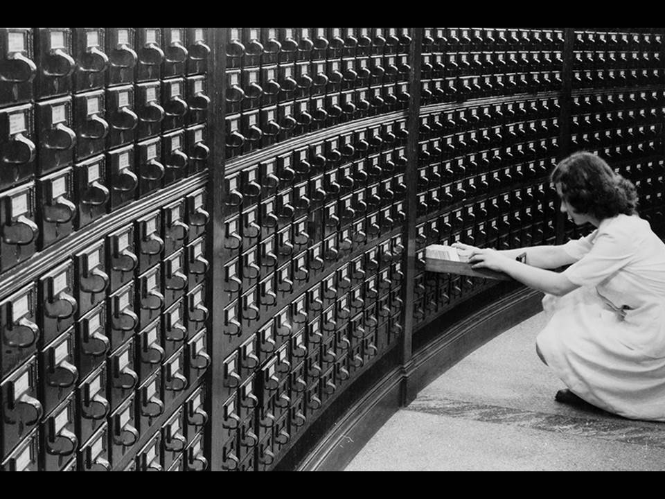 Photo of a person using a card catalog