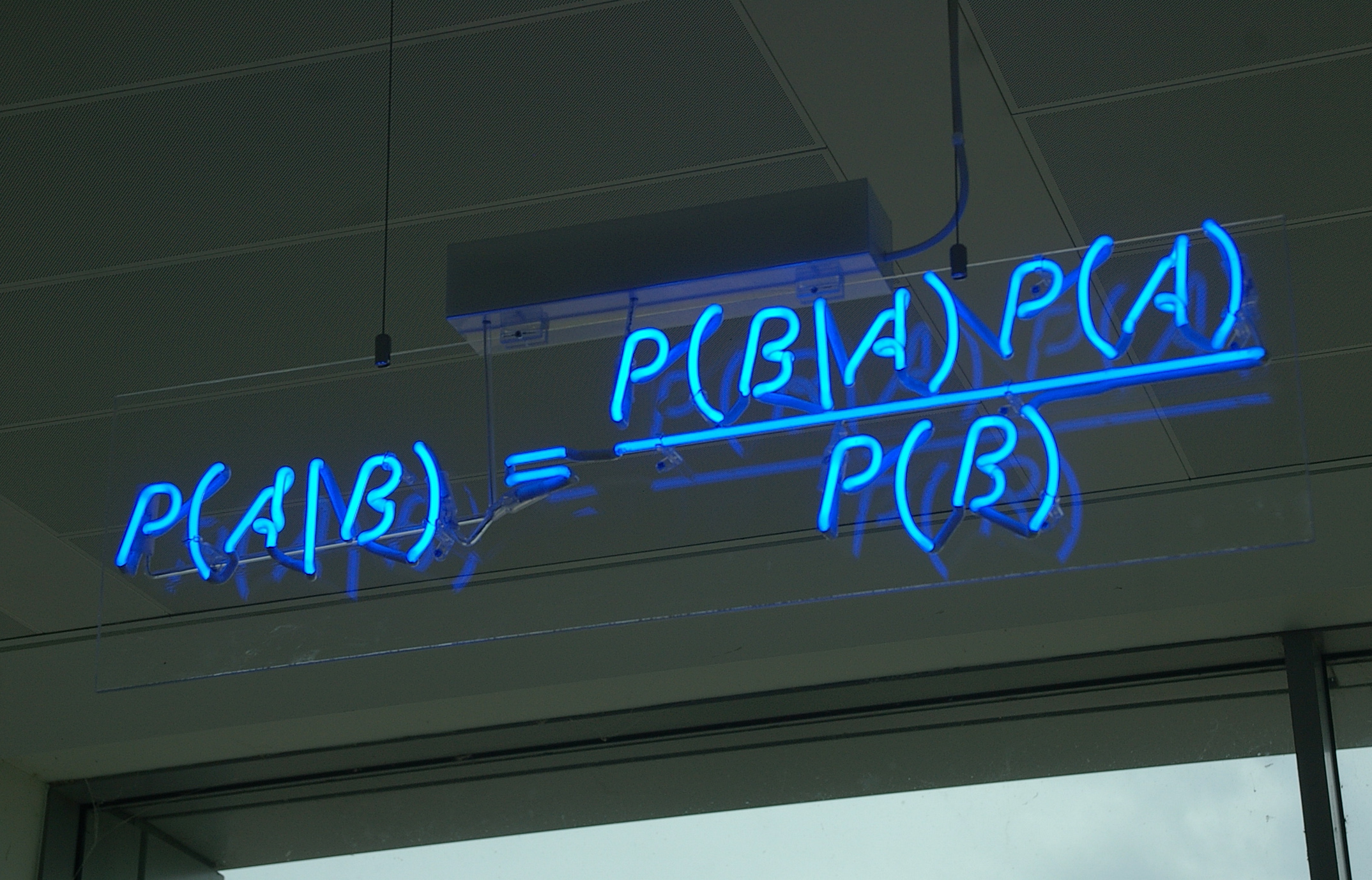 An image in neon of Bayes' theorem